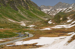 Mountainbikers riding in the Alps. Mountainbikers riding on an over 2000 m trail in the Alps Stock Photography