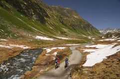 Mountainbikers riding in the Alps. Mountainbikers riding on an over 2000 m trail in the Alps Royalty Free Stock Photography
