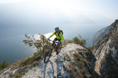 Mountainbiking over the lake garda. A lonley biker search his way over the garda lake Royalty Free Stock Image