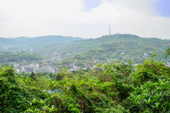 Mountaindside town in cloudy foggy spring Stock Photos