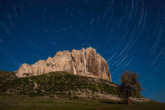 Mountaine and startrails in sky Stock Photography