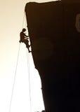 Mountaineer. Climb the rock stock photos