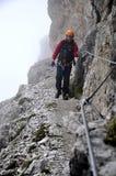 Mountaineer. Hiking in mountains. Via Feratta of Monte Paterno - Dolomites stock image