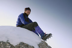 Mountaineer. Relaxing on the rock Stock Images