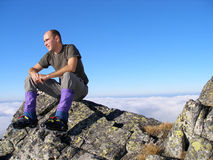 Mountaineer. Relaxing on the rock Royalty Free Stock Photography