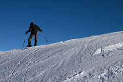 Mountaineer. A young man on skis, mastering the mountains Royalty Free Stock Image