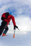 Mountaineer. Climbing a glacier; vertical frame stock photography