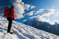 Mountaineer alone glacier. A male mountaineer walking uphill on a glacier. Mont Blanc, France stock photos