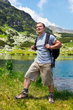 Mountaineer with backpack hiking Royalty Free Stock Photo