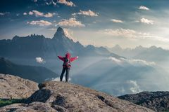 Mountaineer with backpack on rock royalty free stock image
