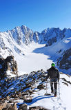 Mountaineer climb to the high mountain peak Royalty Free Stock Images