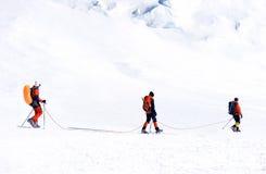 Mountaineer climb to the high mountain peak Royalty Free Stock Photos