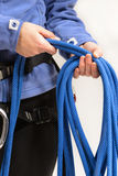 Mountaineer with climbing equipment Stock Photo