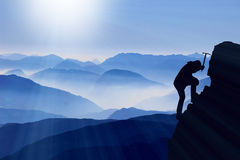Mountaineer climbs summit. Climber climbs summit on a hight mountain Royalty Free Stock Image