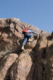 Mountaineer climbs to the top stock photography