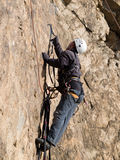Mountaineer crawling on the wall Stock Photography