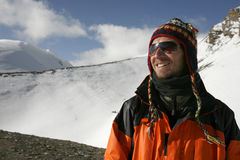 Mountaineer enjoying the summit after a climb up. Thorong-la pass, annapurna, nepal Stock Images