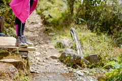 Mountaineer girl standing on the edge of a small bridge Royalty Free Stock Photo