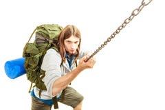 Mountaineer hiking climbing rock mountain. Backpacker mountaineer hiking climbing rock mountain. Young man scrambling mountaineering. Active lifestyle adventure stock image