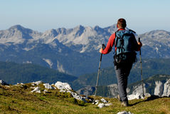 Mountaineer hiking in mountains Stock Images