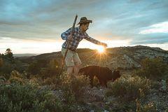 Mountaineer with his dog in the mountains. Guy and dog royalty free stock photography
