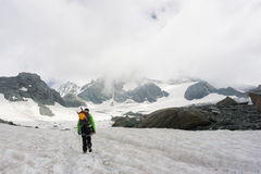 Mountaineer on his way to climb Grossglockner Royalty Free Stock Photo