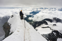 Mountaineer on his way to climb Grossglockner Royalty Free Stock Photos