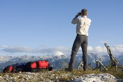 Mountaineer looking through field glasses Royalty Free Stock Images