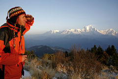 Mountaineer looking at a mountain. Range stock image
