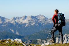 Mountaineer looking on mountains Royalty Free Stock Photo