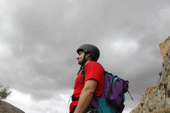 Mountaineer looking to the mountain. With a helmet Royalty Free Stock Photography