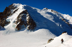 Mountaineer Mont Blanc. Mountaineer in the glacier vallè blanc, Aiguille du Midi, Chamonix, Mont Blanc, West Alps, France, europe stock photography