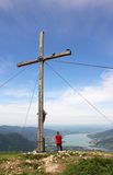Mountaineer and mountain cross, beautiful view over lake tegernsee, bavaria, germany. Mountaineer standing beside mountain cross, beautiful view over lake stock photos