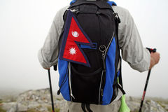 Mountaineer with Nepal flag Stock Photos