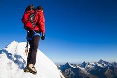 Mountaineer On A Snowy Ridge Royalty Free Stock Photos