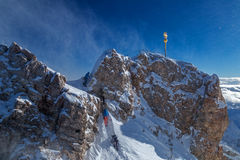 Mountaineer at the peak of Zugspitze, Germany. Mountaineers climb at the peak of Zugspitze, Germany Stock Photo
