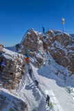 Mountaineer at the peak of Zugspitze, Germany. Mountaineers climb at the peak of Zugspitze, Germany Stock Photos
