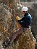 Mountaineer on the rock. Mountaineer climbing on the rock on the rope royalty free stock photography