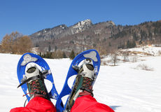 Mountaineer's legs with snowshoes for excursions on the snow Stock Photos