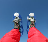 Mountaineer's legs with snowshoes Stock Image