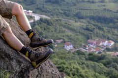 Hiker in boots relaxed on rock royalty free stock photography