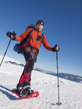 Mountaineer snowshoe is the snow. Stock Photography