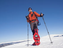 Mountaineer snowshoe is the snow. Royalty Free Stock Images