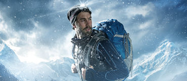 Mountaineer. In the snowy mountains royalty free stock photo