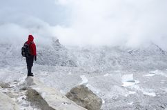 Mountaineer standing near Khumbu Icefall - one of the most dange Royalty Free Stock Image