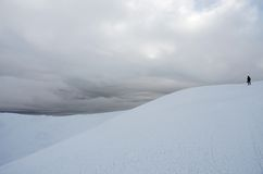 Mountaineer standing on top of Gimba mountain during winter snow Stock Image