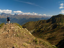 Mountaineer on the top of mountain. Alone man on the top of mountain stock photography