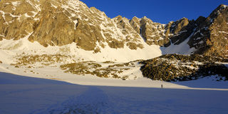 Mountaineer on the trail in the morning Royalty Free Stock Photography