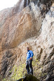 Mountaineer under a waterfall. In Huesca, Spain Stock Images