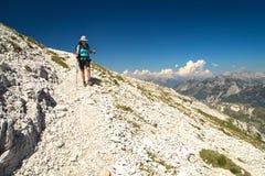 Mountaineer walking on the mountain Peski. Mountaineer on the march to the mountain Peski, Mountain Krn, Julian Alps, Slovenia Stock Photos